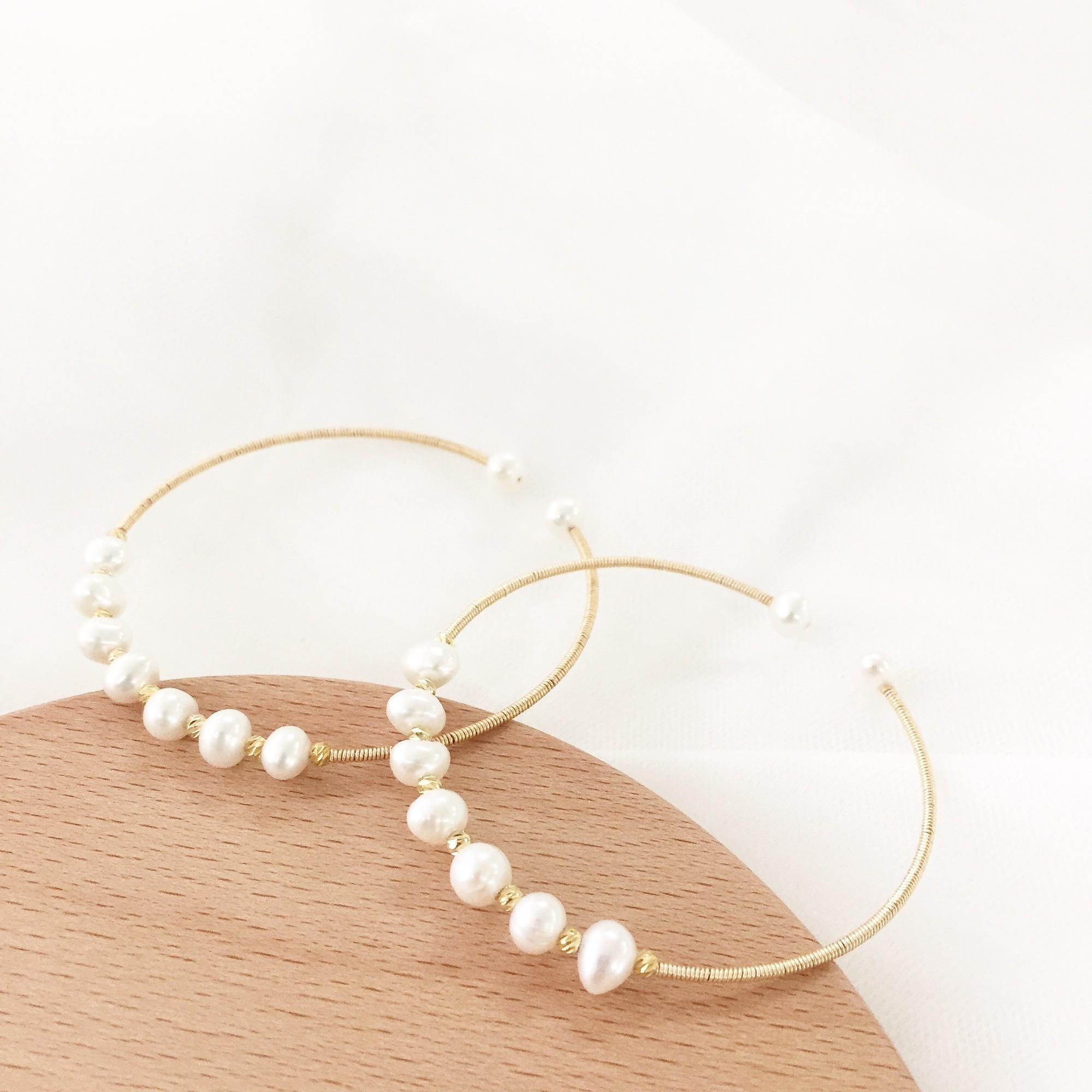 新款简约复古轻奢开口弹簧珍珠个性手镯女纯银
